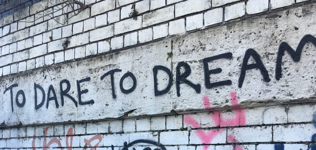 Image of graffiti reading to dare to dream
